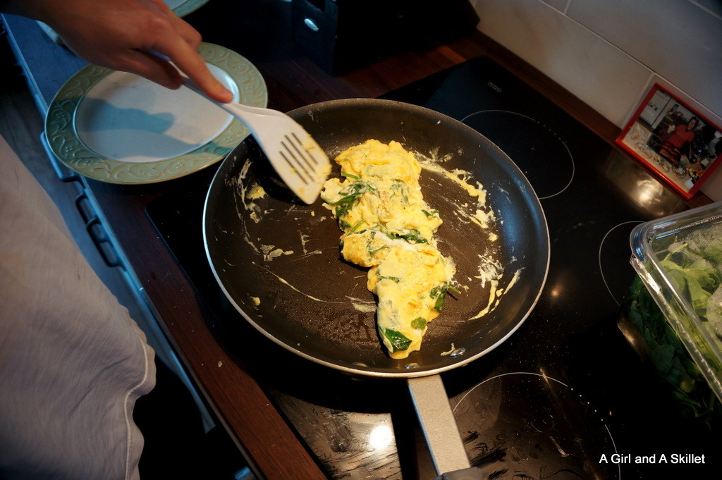 Husband cooking eggs